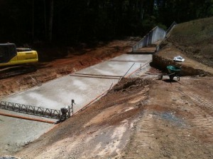 Levelling concrete being placed preparatory to placing chute slab at Manjimup Dam, February 2014