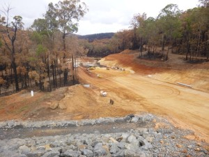 Spillway excavation showing the forest burnt during the recent fires